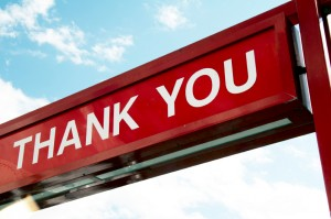sign - THANK YOU - dark red background and white letter, blue sky